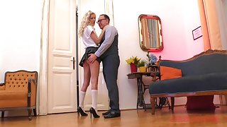 Curly haired blonde in a miniskirt Monique Woods bends over for a fuck